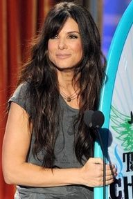Sandra Bullock with super long, wavy hair and bangs