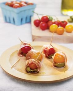 cherry tomatoes wrapped in prosciutto with olives and goat cheese
