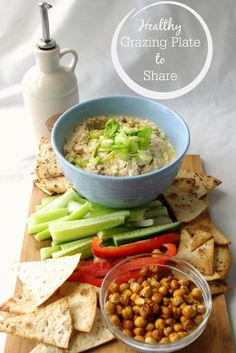 Healthy Grazing Plate to Share: A winning and filling combination of white bean and tuna dip, baked crispy chickpeas, wholegrain tortilla chips and vegetables #shareitwithafriend