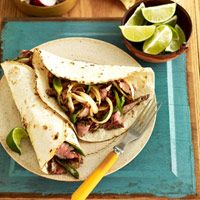 Flank Steak Fajitas Recipe -- Use a cast iron skillet to achieve the perfect doneness for the steaks and vegetables in these delicious fajitas. #myplate #protein #vegetables