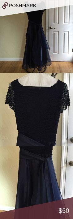 Navy blue gown JS Collections navy blue gown. Lace on top and sheer taffeta overlay.  With removable sheer sash. Recently dry cleaned JS Collections Dresses