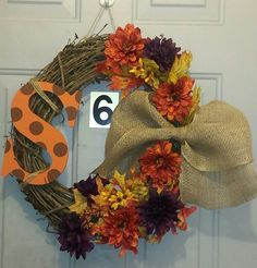 Another beautiful,  classic fall wreath.  Love the burlap bow. It's so full looking with the fall leaves too