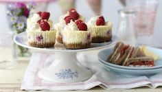 Raspberry Cheesecake Cupcakes by BBC Good Food. Are they a cupcake or are they a cheesecake? Well a little of both. This cupcake recipe is delicious served as a dessert. Cheesecake Cupcakes, Raspberry Cheesecake, Cheesecake Recipes, Cupcake Recipes, Dessert Recipes, Party Recipes, Raspberry Torte, Raspberry Ripple, Cheesecake Bites