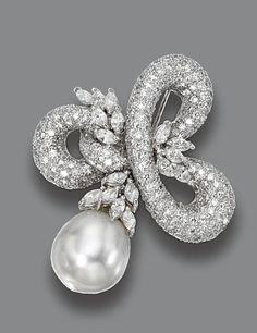 DIAMOND AND CULTURED PEARL BROOCH.  Designed as a scrolling trefoil of pavé-set round diamonds accented with foliate sprays of 17 marquise-shaped diamonds, altogether weighing approximately 5.10 carats, supporting a cultured pearl drop measuring approximately 16.1 by 19.0 mm., mounted in 18 karat white gold.