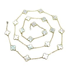 Van Cleef & Arpels Mother of Pearl Yellow Gold Alhambra necklace | From a unique collection of vintage more necklaces at https://www.1stdibs.com/jewelry/necklaces/more-necklaces/