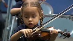 Music can be learned at a very young age. Love this photo.