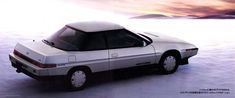 1985 Subaru XT (Alcyone)  The extreme wedge body shape was possible due to the engine's flat horizontally opposed cylinder layout shared by all Subarus in 1985. The result was one of the most aerodynamic production cars of its time.   I had a 1988 one and I loved it!