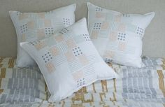 A trio  of MATAYARISHO CUSHION beautifully hand embroidered by KISANY Living Linens for OTAGO design using exclusive Libeco Linen.