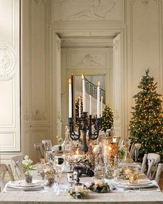 LOVE the simplicity of an evergreen wearing white lights and nothing else...so chic!