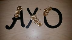 AXO gold and black letters