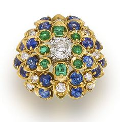 A diamond, sapphire and emerald dome ring, David Webb centering an old European-cut diamond surrounded by round sapphires, emeralds and round brilliant-cut diamonds, mounted in eighteen karat gold;