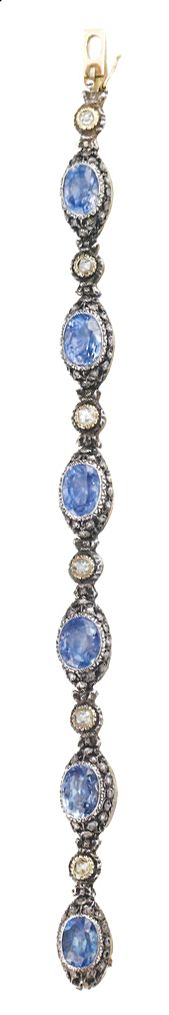 Silver and 18K Gold bracelet with 5 Carats of Diamonds and 20 Carats of unheated Ceylonese Sapphires. From an Italian Noble Family. Originally a Tiara from 1830, remade into a bracelet by Buccellati in 1935.