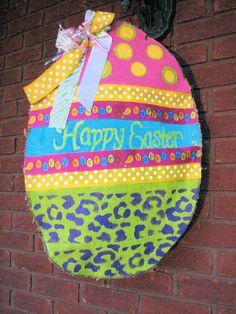 Painted Burlap Easter Egg Door Hanger. $38.00, via Etsy.