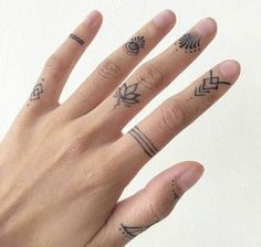 Bands and floral finger tattoo