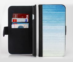 The Fading Light Blue Streaks Ink-Fuzed Leather Folding Wallet Credit-Card Case for the Apple iPhone 6/6s, 6/6s Plus, 5/5s and 5c from DesignSkinz