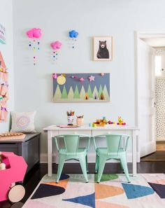 """Kids rooms are the most fun rooms to designbecause you don't have to follow all the normal """"adult"""" rules (Pastel walls? Graphic patterned rug? Neon art? We go there … fast). We just finished this cute playroom for a Los Feliz client, and I love that it's a space that can grow with their two daughters. That craft table literally gets taller when they do, since it comes with different leg heights you can easily switch out. xx Emily Henderson Design Tessa Neustadt - Neustadt Blog liketk.i..."""