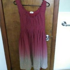 Converse ombre dress Size medium Converse All Star dress. This dress zips on the side and ties in the back. I loved this dress but it fit a little tight on my chest and I'm a 36B. Fit past my knee and I'm 5'4. Hope this helps. I do trade. Make me an offer! Converse Dresses Midi