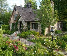 Create soft meandering pathways instead of those that follow a straight, structured line. Many paving materials work in cottage gardens, including wood chips, stone, old bricks, and flagstone.