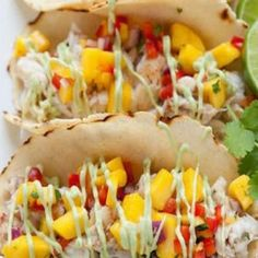These tacos feature lightly marinaded white fish topped with a mango salsa and creamy avocado sauce. This recipe is easy and delicious, and is sure to quickly become a. Sauce Recipes, Seafood Recipes, Mexican Food Recipes, Cooking Recipes, Healthy Recipes, Ethnic Recipes, Basa Fish Recipes, Cooking Icon, Dinner Recipes