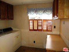 The home has a good size kitchen that opens up to both the living and dining room which is great for entertaining. Mls Listings, Property For Sale, Kitchen Cabinets, Dining Room, Real Estate, California, Entertaining, Home Decor, Decoration Home