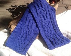100 % wool, soft wool Medium blue 7 inches by 58 inches Soft, warm, classic cable Hand wash cool, roll in towel, lay flat to dry for best results soft, warm and classic One of a kind READY TO SHIP A classic blue winter scarf that will go with most any winter wear Each item is a unique design and hand knitted. After many long Minnesota winters, I found a pop of color helped brighten the day. Besides, there are so many wonderful yarns to match to new designs. ColorWondreWarmth hopes to…