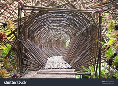 http://www.shutterstock.com/pic-179290043/stock-photo-the-bamboo-tunnel-in-the-garden-bamboo-walk-way.html?src=z1Js5wc…