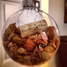 Christmas ornament made from dried wedding flowers and a cork from the wedding!