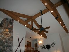 It's easy to install track lighting in a modified king truss when using faux wood beams (Raised Grain are shown here) because they're hollow so it's easy to run wires and drill into them.