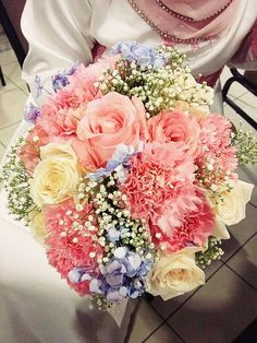 Lush Pastel Wedding Bouquet Arranged With: Baby Blue Hydrangea, White Roses, Pink Roses, Pink Carnations & White Baby's Breath (Gypsophila)