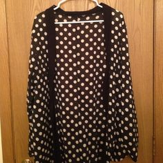Kardashian kollection polka dot open cardigan! Polka dot open face cardigan that makes looking nice super easy! It has a black trim around it. I'm not sure if it's size large or medium (i'm currently at work) but it will fit size medium- xl! On mediums it will be extra flowy and on xl it won't cover as much of the front. The dots are an off white- the modeled pic looks white but it's off white Kardashian Kollection Tops