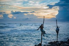 Stilt Fishermen Photo by Jino Lee — National Geographic Your Shot