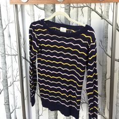 """Urban Outfitters Pins and Needles Striped Sweater Urban Outfitters Pins and Needles Lightweight sweater with scalloped detail. Scoop Neck. Allover stripes. Ribbed detail at the neck, hem and cuffs. 24""""L from shoulder to hem.                 UO Exclusive                                                                   Content and Care: Acrylic. Machine Wash. Made in the USA. Brand New Condition.  Navy Blue with Yellow, Cream and Light Pink Stripes. Urban Outfitters Sweaters Crew & Scoop…"""