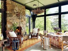 The Lakehouse  lake house on the shores of Upper Saranac Lake in New York's Adirondack Mountains. Designed by architecture firm Shope Reno Wharton, with interiors by Thom Filicia