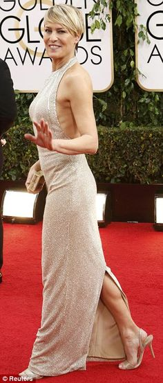 Sparkling: Robin sparkled in her gold Reem Acra halter gown with Jimmy Choo Tiga sandals a...
