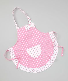 For those early-start master chefs, this apron is equal parts fun and functional. Boasting a smattering of polka dots, ruffle-rich hem and handy front pocket, this piece will keep little ones stylish and clean during their culinary creations.