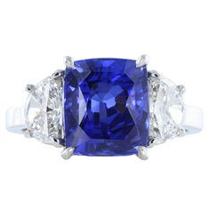 4.13 Carat No Heat Burma Sapphire Diamond Platinum Three Stone Ring | From a unique collection of vintage three-stone rings at https://www.1stdibs.com/jewelry/rings/three-stone-rings/