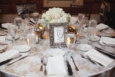 Classic, glamorous reception decor and tabletop in shades of ivory and champagne, photo by leslie-hollingsworth.com