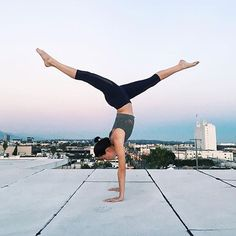 @aeriallynn getting her handstand on in the Vixen Fitted Crop & Airbrush Capri. #aloyoga #beagoddess