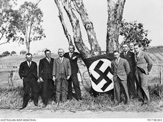 Members of the Nationalist Socialist Democratic Works Party in SA, 1934. During the Great Depression, many Australians lost confidence in  their government. Radical or extremist organisations became popular because of public dissatisfaction. On the political left communist, socialist, workers and unemployed organisations actively opposed forced house evictions, while  fascist-style groups like the New Guard enjoyed increased membership on the right of politics. Terra Australis, Workers Party, Nazi Propaganda, Make Do And Mend, Great Depression, Interesting Reads, Reference Images, World War Ii, The Past