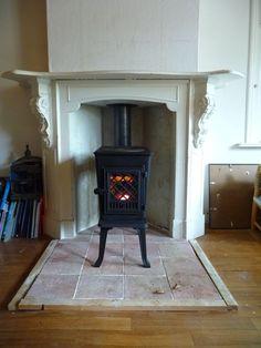 Wonderful Jotul Wood Stove Fireplace For Warming Room Furniture Ideas: Awesome Dark Jotul Wood Stove Fireplace Before Wonderful White Mantel Kit For Warming Room Decor Ideas