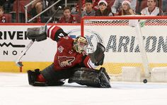 GLENDALE, AZ - DECEMBER 10: Goalie Mike Smith #41 of the Arizona Coyotes deflects the puck wide of the net against the Nashville Predators during the third period at Gila River Arena on December 10, 2016 in Glendale, Arizona. (Photo by Norm Hall/NHLI via Getty Images)