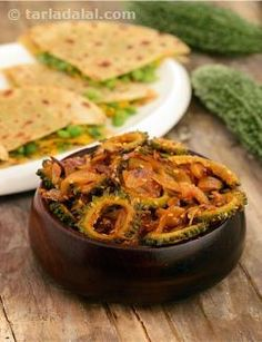 Wonderfully flavourful, this Onion and Karela Subzi is perked up not just by the pungency of onions, but also by the aroma of roasted sesame seeds and the tanginess of amchur powder. Together, these ingredients complement the bitterness of karela very well, making it not just palatable but quite enjoyable too!