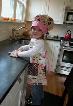 This is too cute--apron, chef's hat and oven mitt! Birthday idea for Miss K. Now to find the perfect fabric to make it out of!