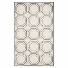 "Stylishly anchor your living room or master suite with this alluring loomed rug, showcasing an eye-catching geometric motif in ivory and light grey.  Product: RugConstruction Material: PolypropyleneColor: Ivory and light greyFeatures:  Power-loomed0.25"" Pile height Note: Please be aware that actual colors may vary from those shown on your screen. Accent rugs may also not show the entire pattern that the corresponding area rugs have.Cleaning and Care: Professional cleaning recommended"