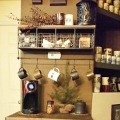 Home Coffee Bars and Coffee Stations Ideas • Coffee Bar Mug Rack • Coffee Bar Shelf With Hooks • Coffee Bar Ideas • Home Coffee Station Ideas • Coffee Station Kitchen DIY Ideas • Kitchen Coffee Bars • Coffee Corner - Coffee Nook Ideas • Home Coffee Bar Wall Shelf and Accessories