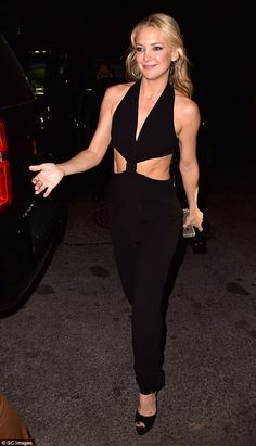 Abs-olutely fabulous: Kate Judson wowed onlookers when she stepped out in a revealing jump...