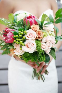 Giant Protea + Rose Bouquet -- Modern Wedding Romance. See more on #SMP here:  http://www.StyleMePretty.com/2014/05/13/brooklyn-wedding-inspiration-built-for-two/ Photography: AmyAnaiz.com -- Floral Design: MakiniRegalDesigns.com