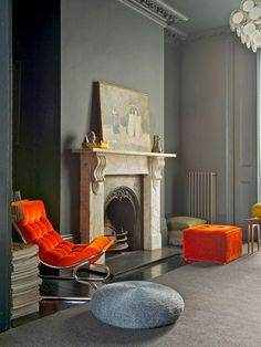 PIN # 9 The focal point is the orange chair and the ottoman it really stands out the ottoman catches my eye at first but then it bounces with the painting then to he chair.