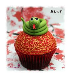 Chinese New Year Cupcakes by Victorious Cupcakes.  Red egg and ginger cupcakes for babies born the year of the snake.