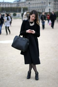 black midi full circle skirt with black fitted sweater and long black coat | black on black fall winter style | large crystal bib necklace | black structured handbag and black ankle boots | red lipstick | wavy golden brown tresses #paris #tuileries #louvre #blackonblack #redlips #frenchfashion